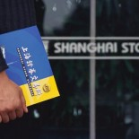 Businessman at Shanghai Stock Exchange